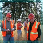 Dr. Terry Moore, left, with Atlantic Richfield's Remediation Management team, and Dr. Frank Hons, Texas A&M University soil and crop sciences professor, examine the revegetation results of dredged sediments from Milltown Lake near Missoula, Mont.